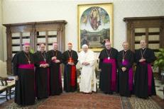 Pope Benedict XVI poses with Italian cardinal Bagnasco and bishops from the Liguria region during a meeting at the Vatican